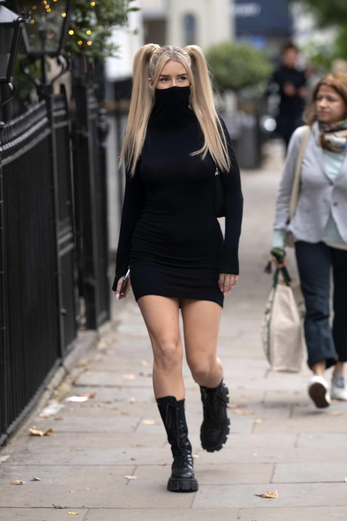 Lottie Moss steps out wearing PrettyLittleThing's black Mask Dress in London, UK