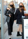 Maddie Ziegler steps out with a friend wearing a black leather jacket at City Market South in Los Angeles