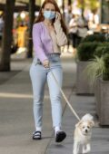 Madelaine Petsch wears two-toned sweater and skinny jeans while out walking her dog in Vancouver, Canada