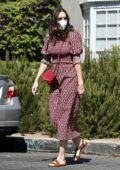 Mandy Moore shows off her growing baby bump in a printed dress as she visits an acupuncture center in Los Angeles