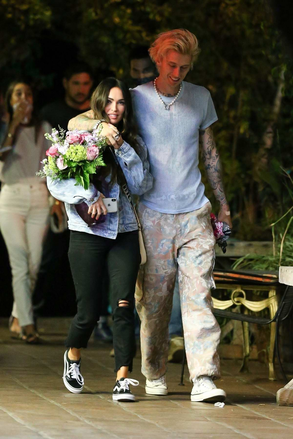 Megan Fox is all smiles while out on a romantic dinner date with Machine Gun Kelly in Hollywood, California