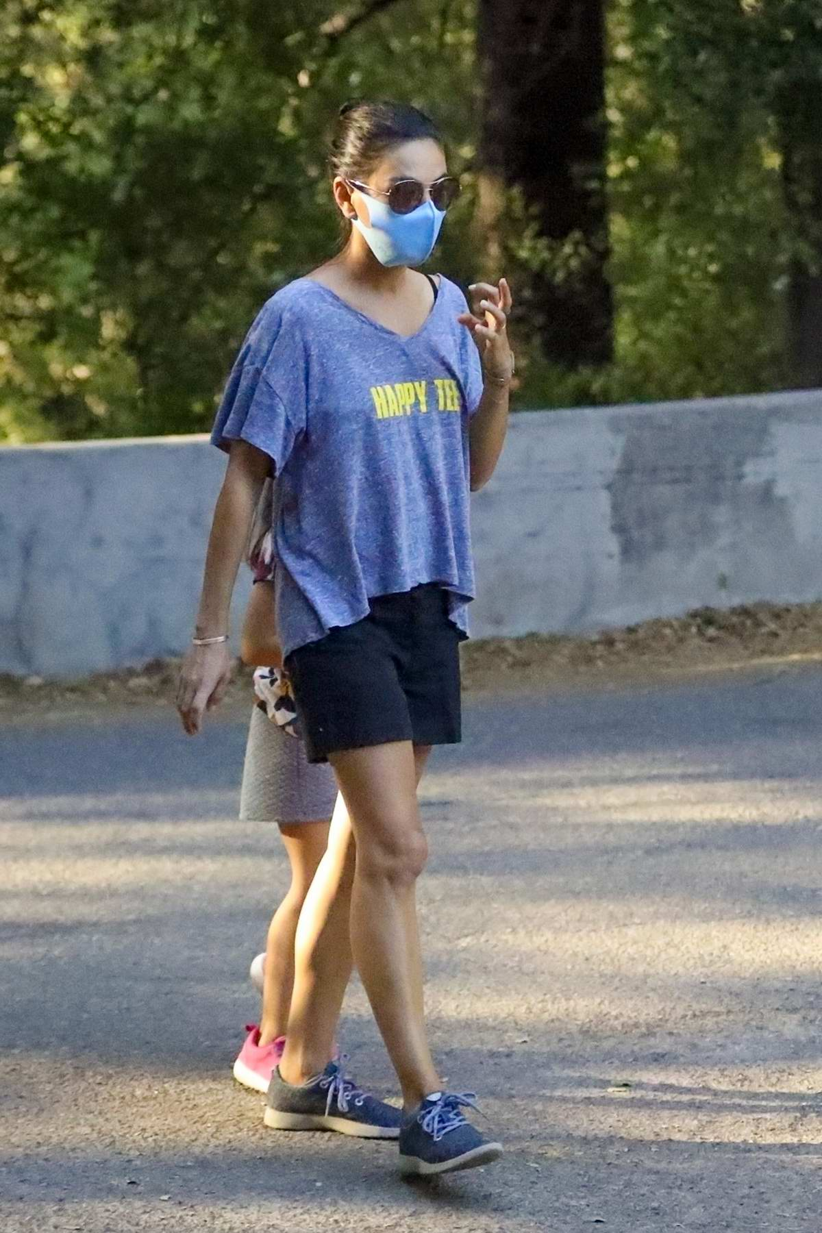 Mila Kunis and Ashton Kutcher enjoy an afternoon hike with their kids and a friend in a Los Angeles