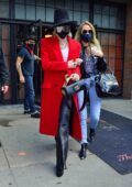 Miley Cyrus looks chic in a red trench coat paired with black leather pants as she heads out of The Bowery Hotel in New York City