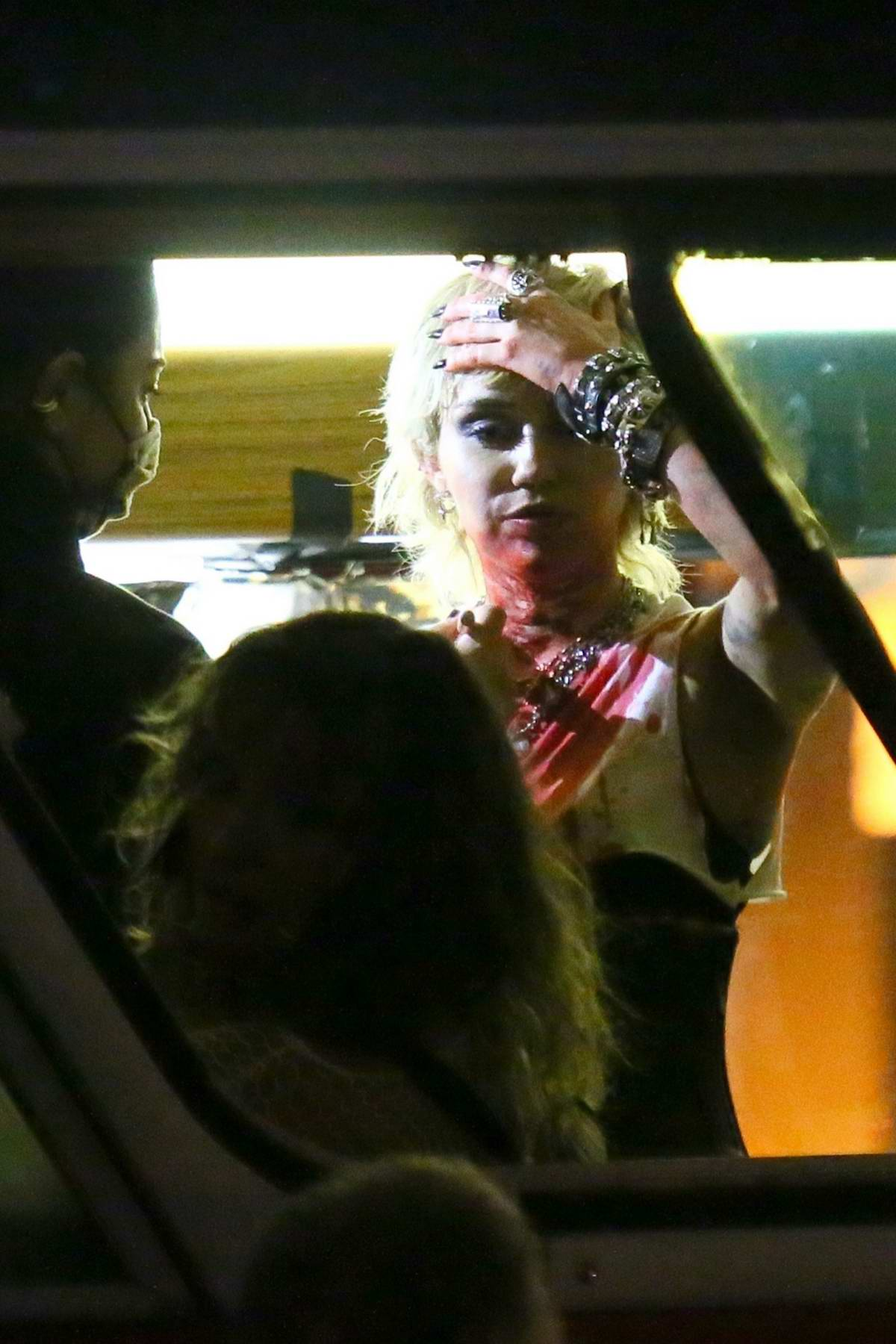 Miley Cyrus seen covered in fake blood while filming her new video in Brooklyn, New York
