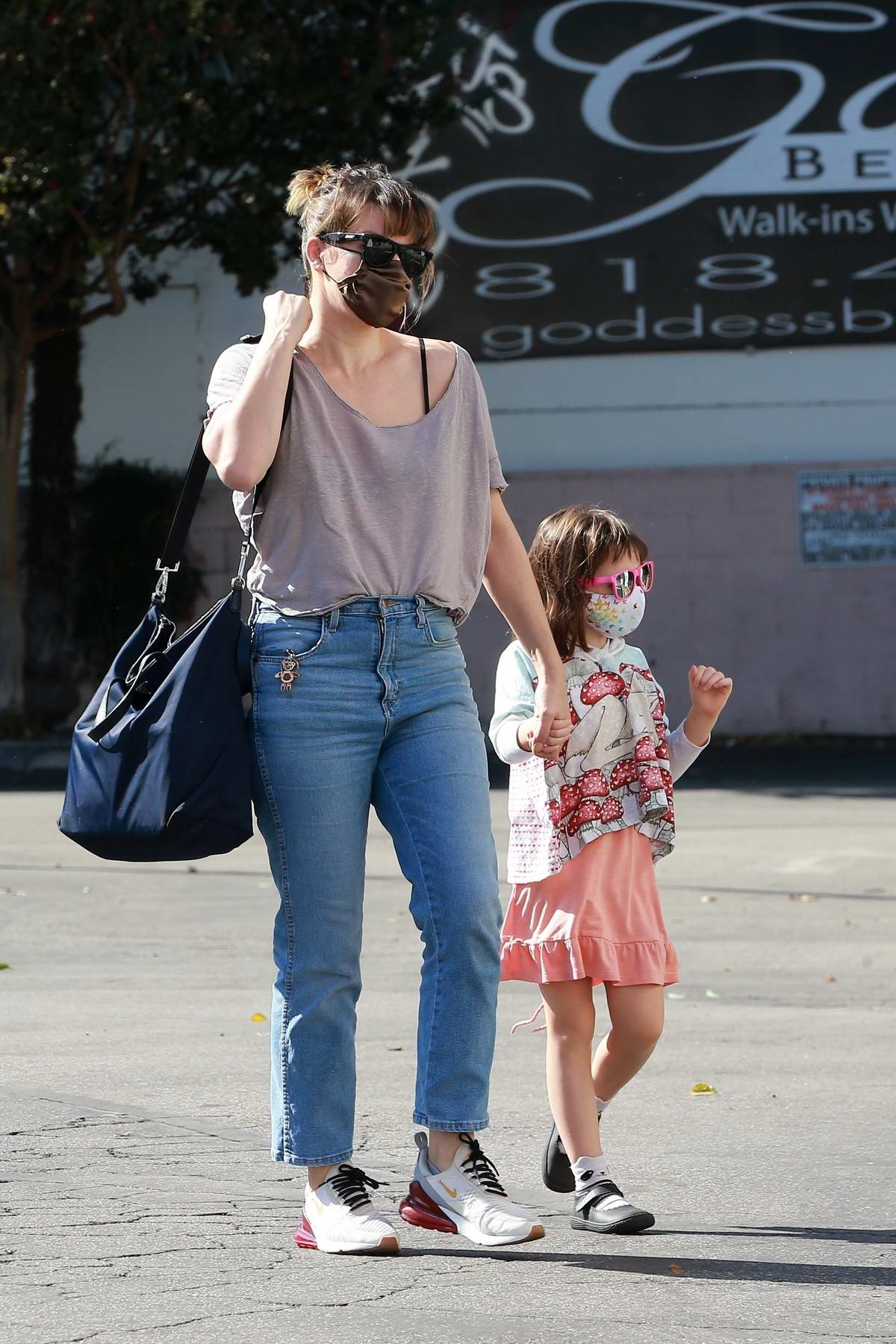 Milla Jovovich takes her daughter shopping at a Halloween store in Studio City, California