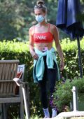 Nina Agdal flaunts her toned abs while conducting a yoga class in the Hamptons, New York