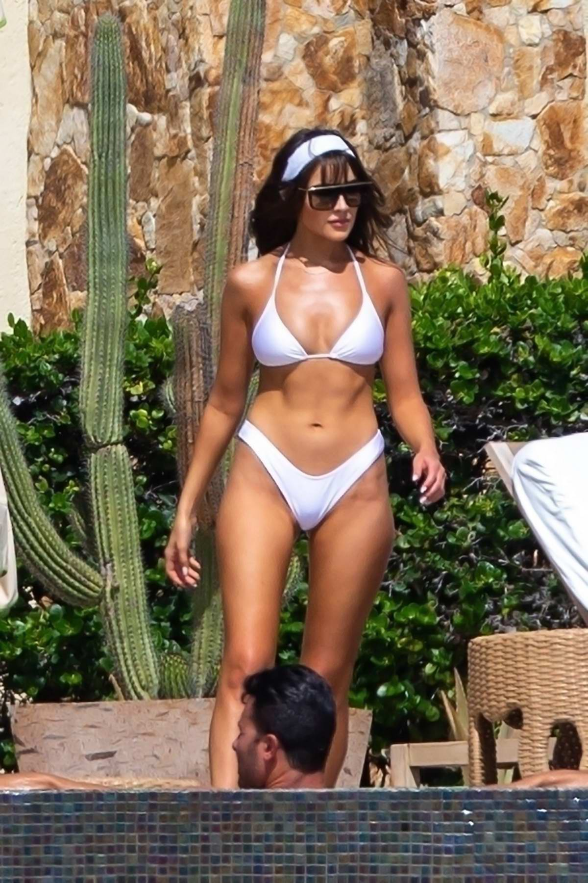Olivia Culpo looks stunning in a white bikini while relaxing by the pool during her vacation in Cabo San Lucas, Mexico