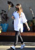 Olivia Munn leaves the gym sporting a white sweatshirt and black leggings in Los Angeles