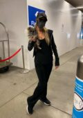 Paris Hilton seen with her pup and boyfriend Carter Reum as she touches down LAX airport in Los Angeles