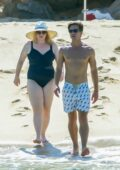 Rebel Wilson slips into a black swimsuit while on a romantic getaway with boyfriend Jacob Busch in Cabo San Lucas, Mexico