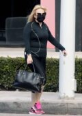 Rebel Wilson spotted in all-black workout gear as she leaves the gym in West Hollywood, California