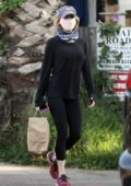 Renée Zellweger steps out to walk her dogs before making a grocery run in Santa Monica, California
