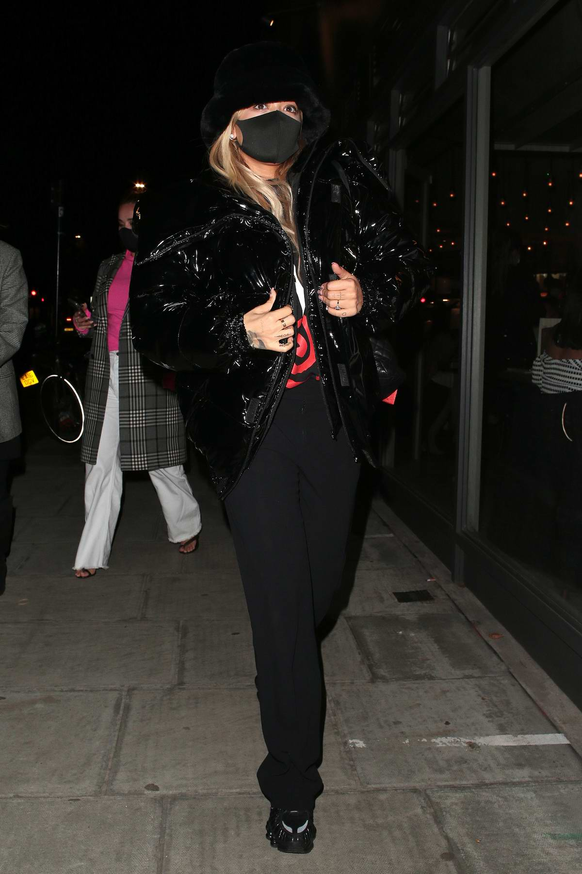Rita Ora dons all black while out for dinner with friends at Taqueria Mexican restaurant in Notting Hill, London, UK