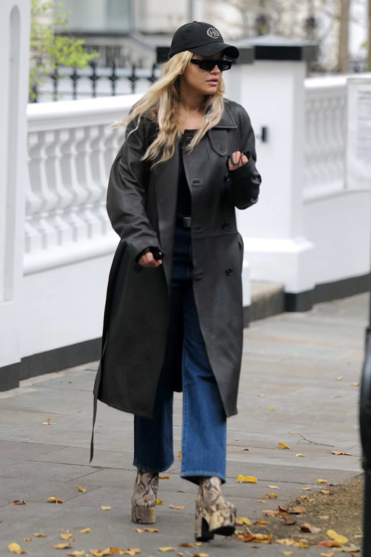 Rita Ora seen wearing a dark trench coat while heading out to a recording studio in London, UK