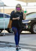 Sarah Michelle Gellar puts in her AirPods while heading for a workout session at Plate Fit in Brentwood, California