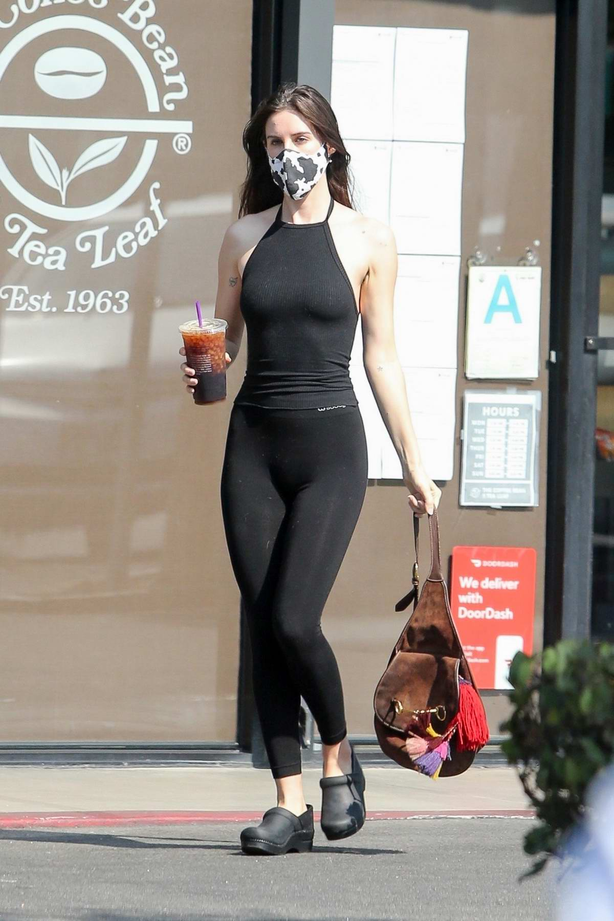 Scout Willis shows off her toned figure in black leggings and top during a coffee run in Los Feliz, California