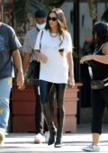 Shay Mitchell waves a Canadian flag while filming a project with boyfriend Matte Babel in Los Angeles