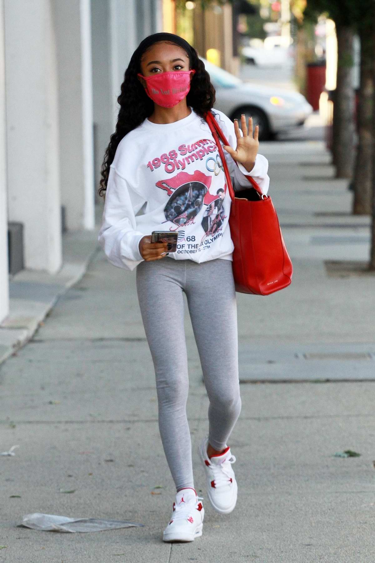 Skai Jackson sports a vintage 1968 Summer Olympic shirt with grey leggings as she heads to the DWTS studio in Los Angeles