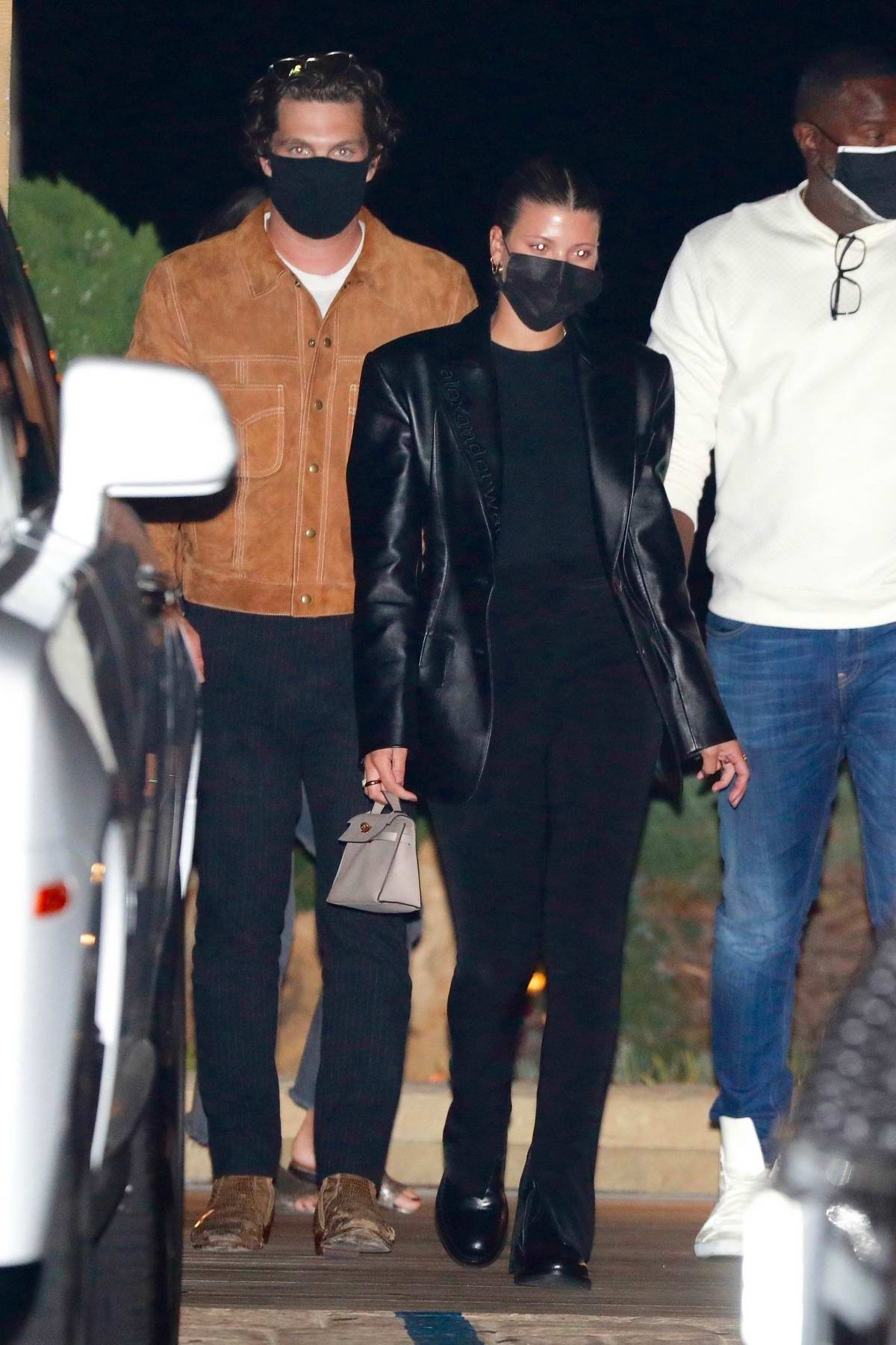 Sofia Richie keeps a low profile leaving dinner with a mystery man at Nobu in Malibu, California