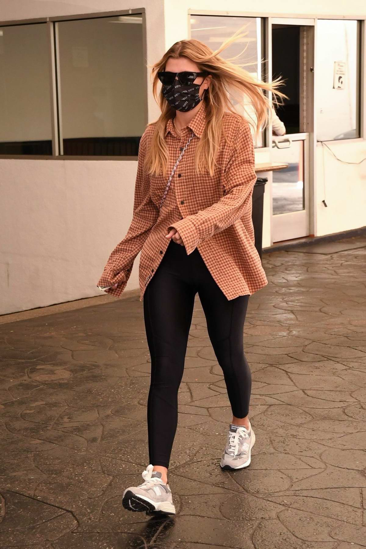Sofia Richie wears a checkered shirt and leggings for a lunch outing with Fai Khadra and a few friends in Beverly Hills, California