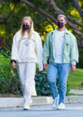 Sophie Turner and Joe Jonas enjoy their evening walk with their baby around the neighborhood in Los Angeles
