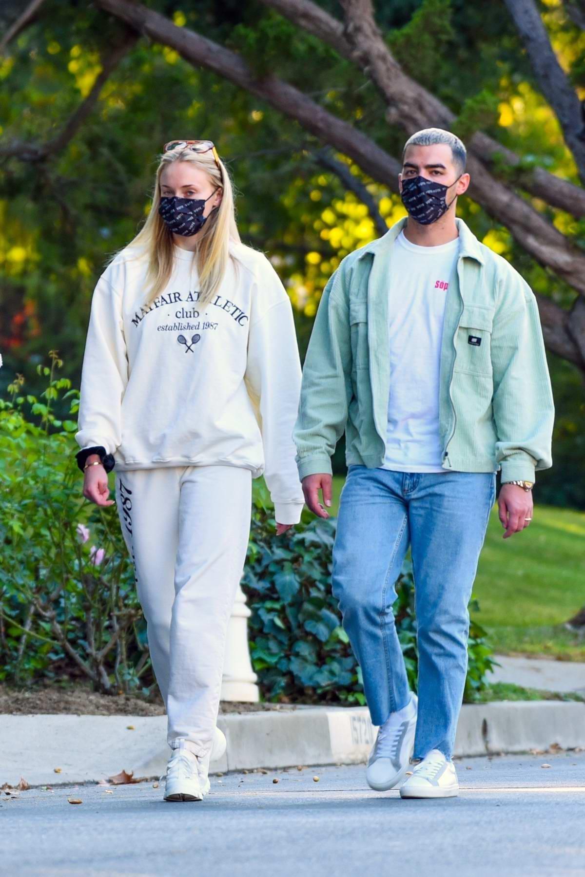 Sophie Turner and Joe Jonas enjoy their evening walk with their baby around the neighborhood in Los Angeles