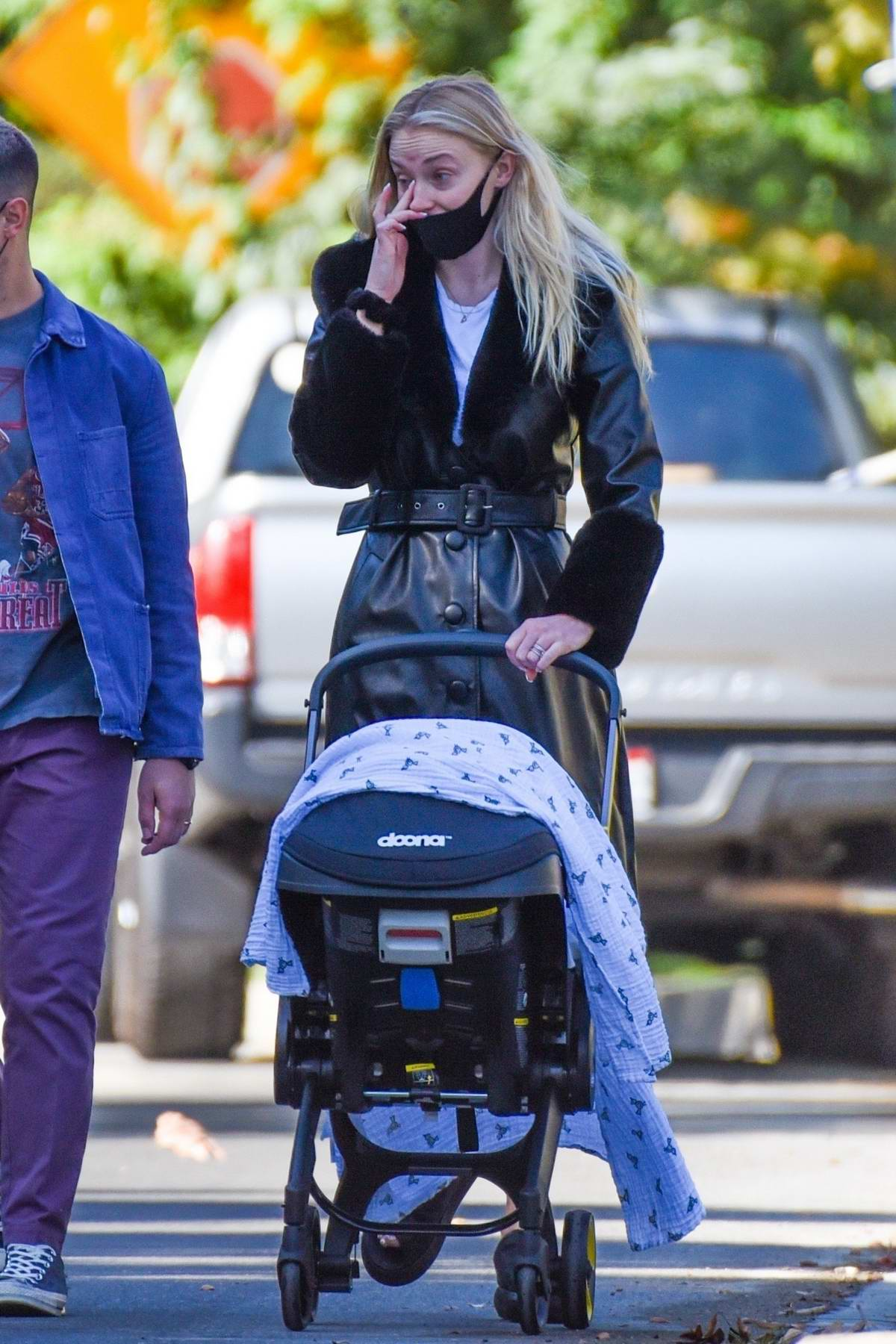 Sophie Turner and Joe Jonas get some fresh air during a stroll with their daughter in Los Angeles