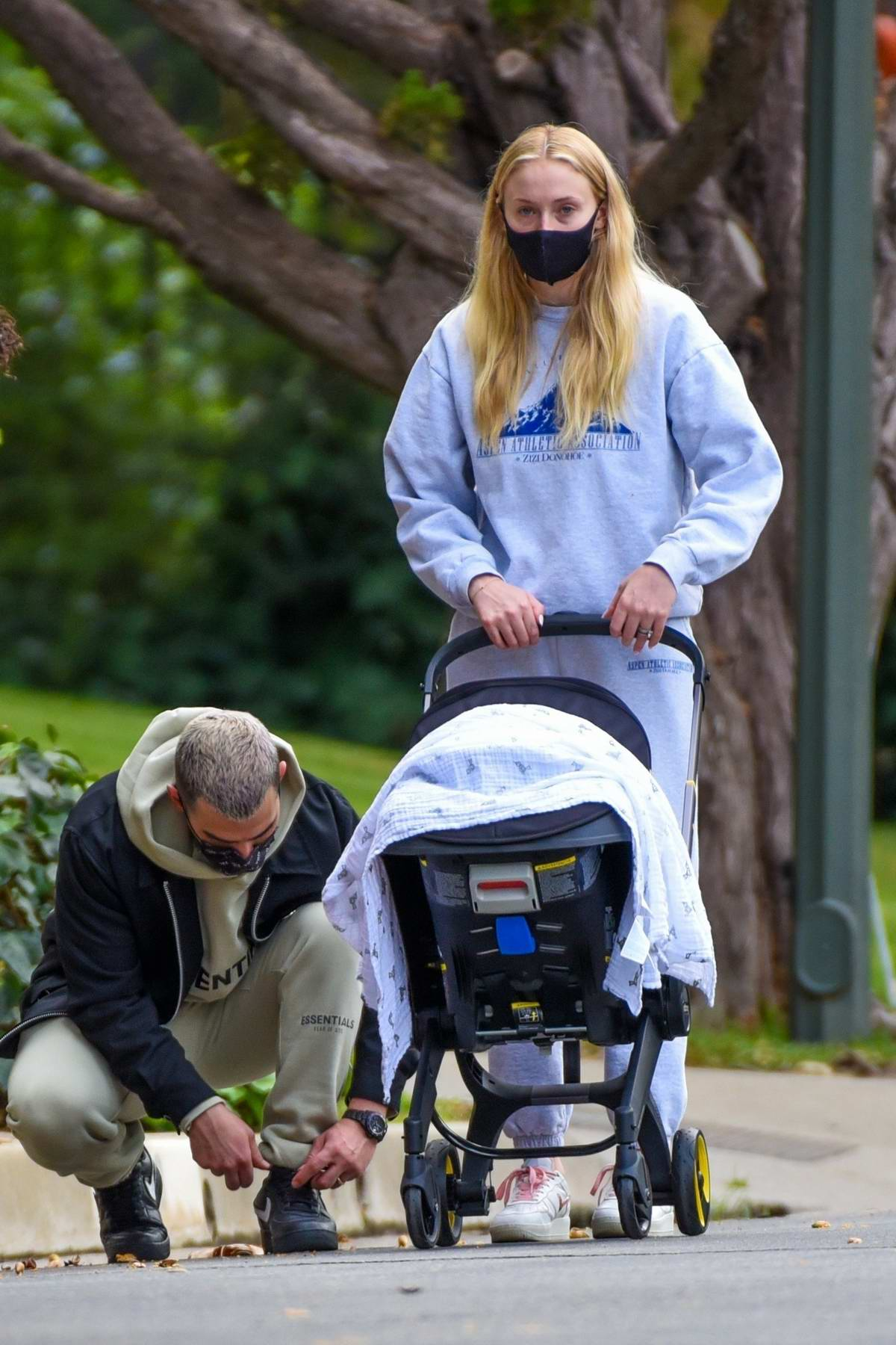 Sophie Turner and Joe Jonas take their baby daughter Willa out for a Sunday stroll with her nanny in Los Angeles
