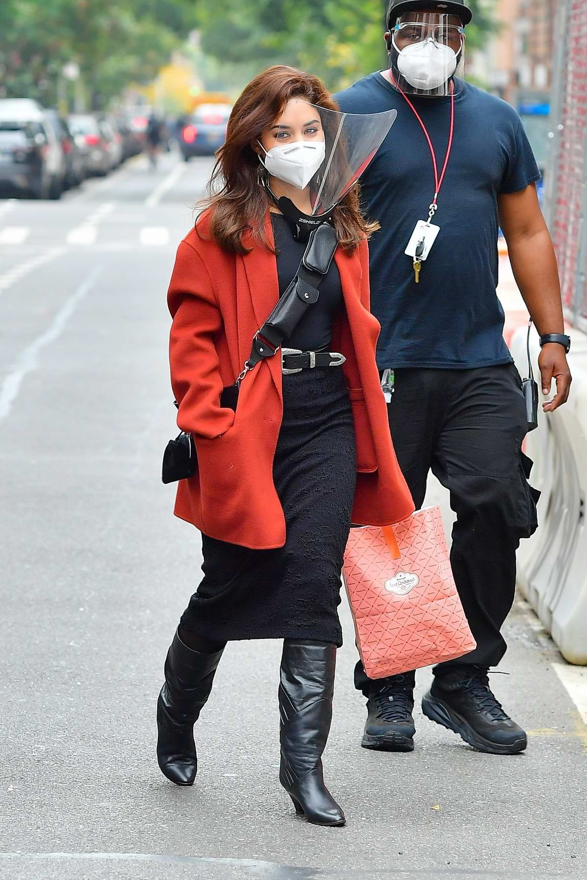Vanessa Hudgens dons a burnt orange coat over an all-black outfit on the set of the 'Tick, Tick...Boom!' in New York City