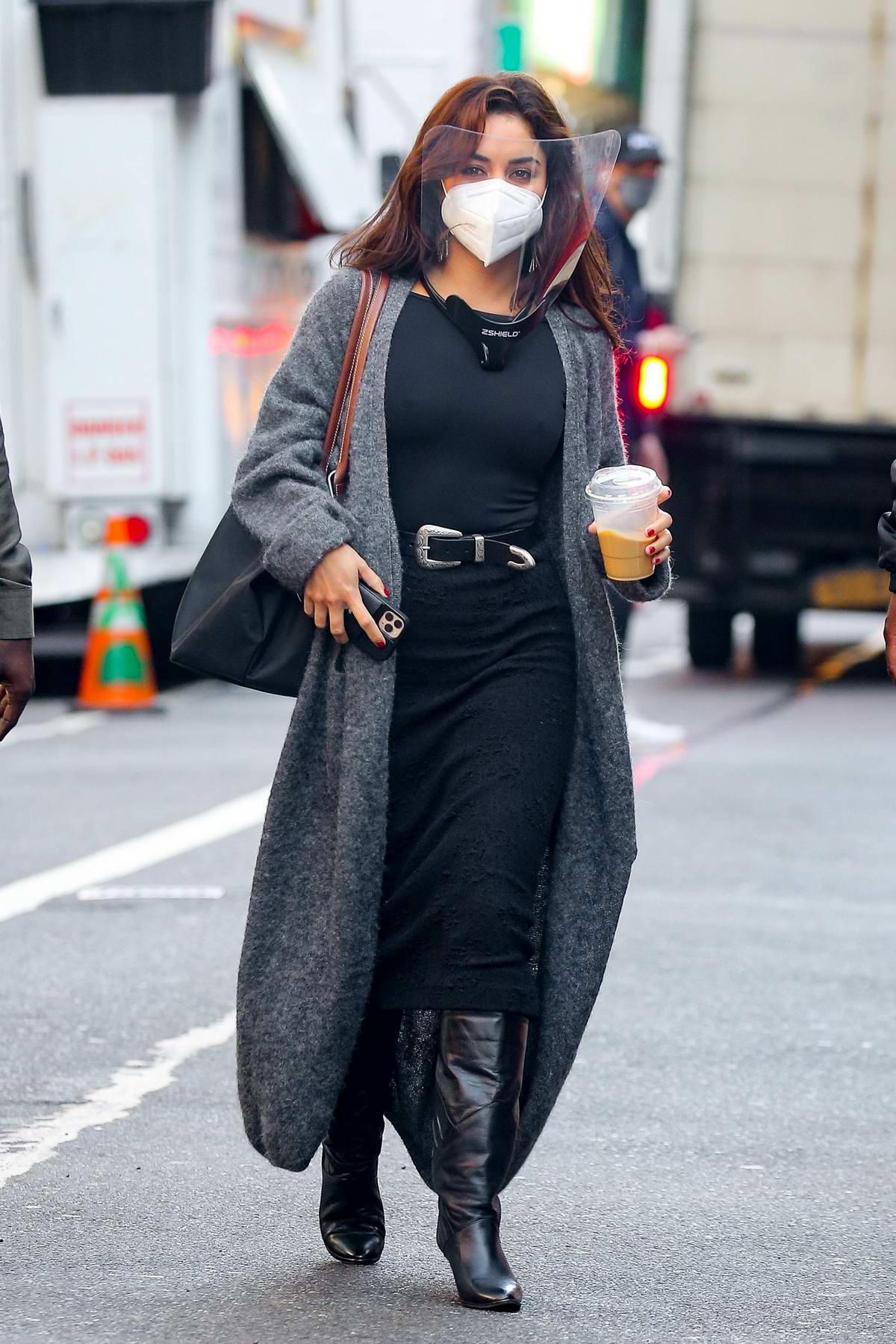 Vanessa Hudgens dons all-black as she arrives holding an iced coffee on the set of 'Tick, Tick...Boom!' in New York City
