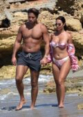 Yazmin Oukhellou looks amazing in a floral print bikini while enjoying a walk along the beach with James Lock in Cyprus