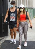 Addison Rae looks great in a red crop top and animal print leggings as she hits the gym with boyfriend Bryce Hall in Los Angeles