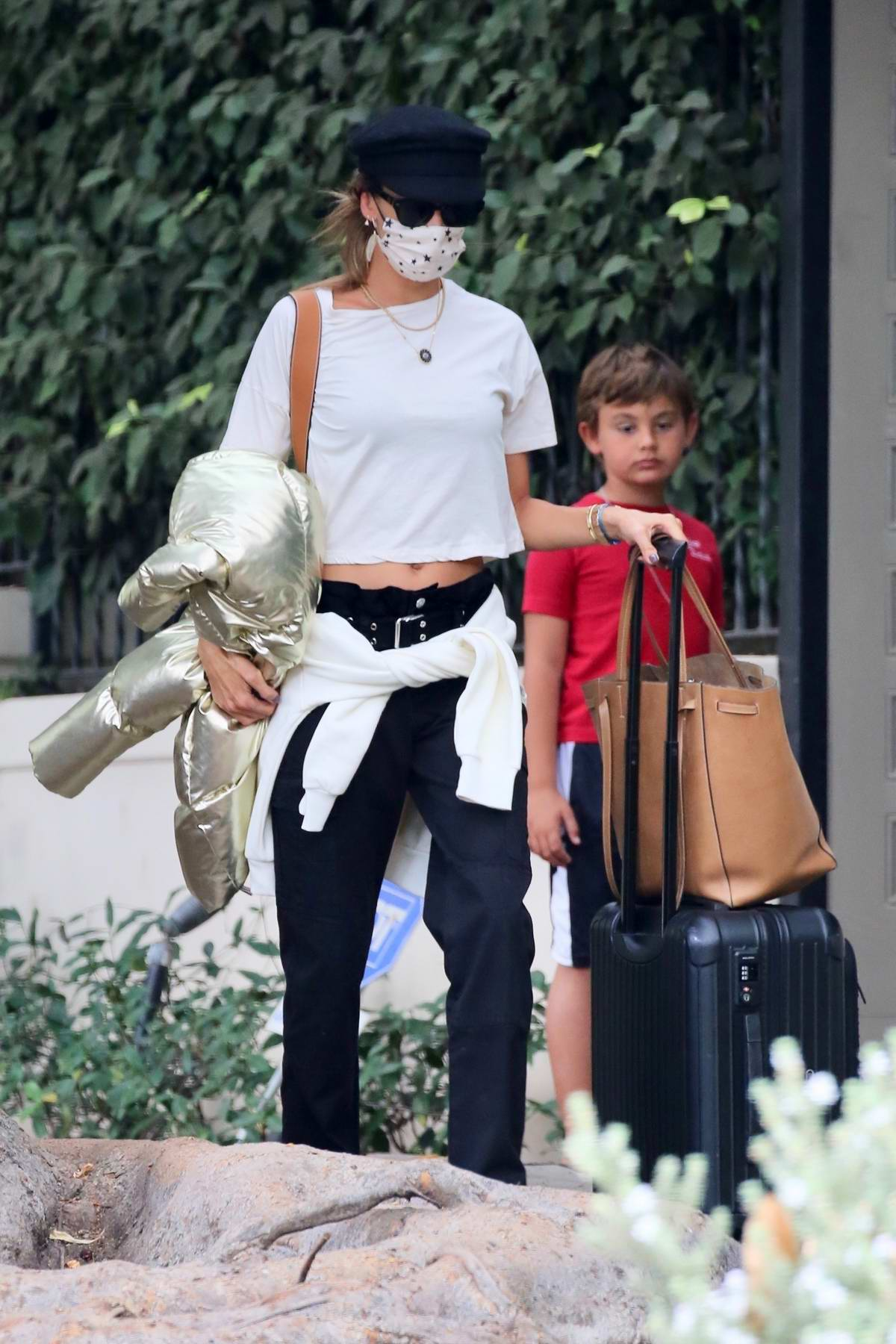 Alessandra Ambrosio keeps things casual while heading out for the airport in Los Angeles