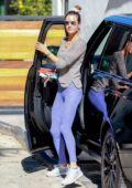 Alessandra Ambrosio rocks grey sweatshirt and purple leggings as she arrives for her Pilates class in Los Angeles