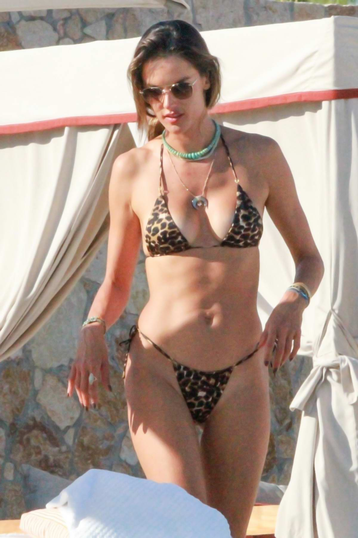 Alessandra Ambrosio stuns in a leopard print bikini during a getaway vacation in Cabo San Lucas, Mexico