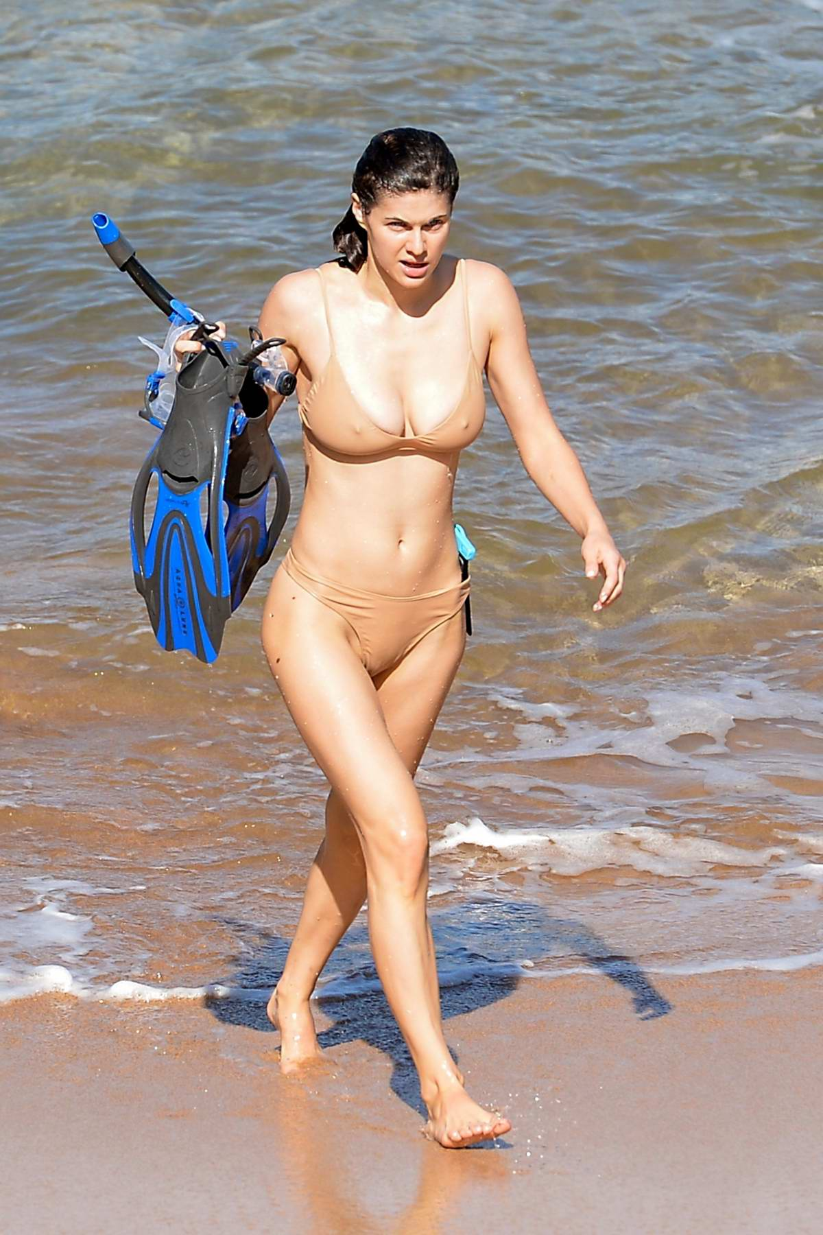 Alexandra Daddario stuns in a beige bikini as enjoys some snorkeling in Maui, Hawaii