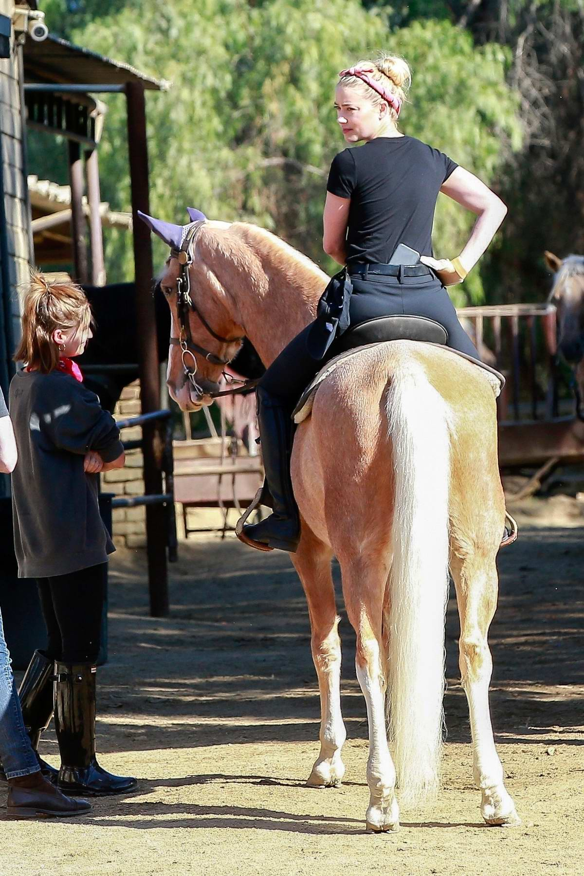 Amber Heard has fun while out horseback riding with girlfriend Bianca Butti and friends in Studio City, California