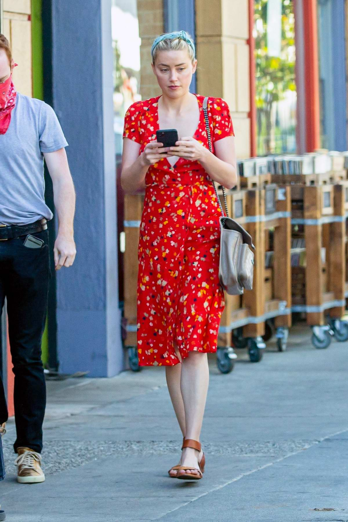 Amber Heard looks lovely in a bright red floral print dress while out shopping at the farmers market in Los Angeles