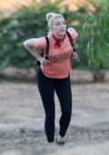 Amber Heard wears a pink tee and black leggings for an afternoon hike with her dog and a friend in Los Angeles