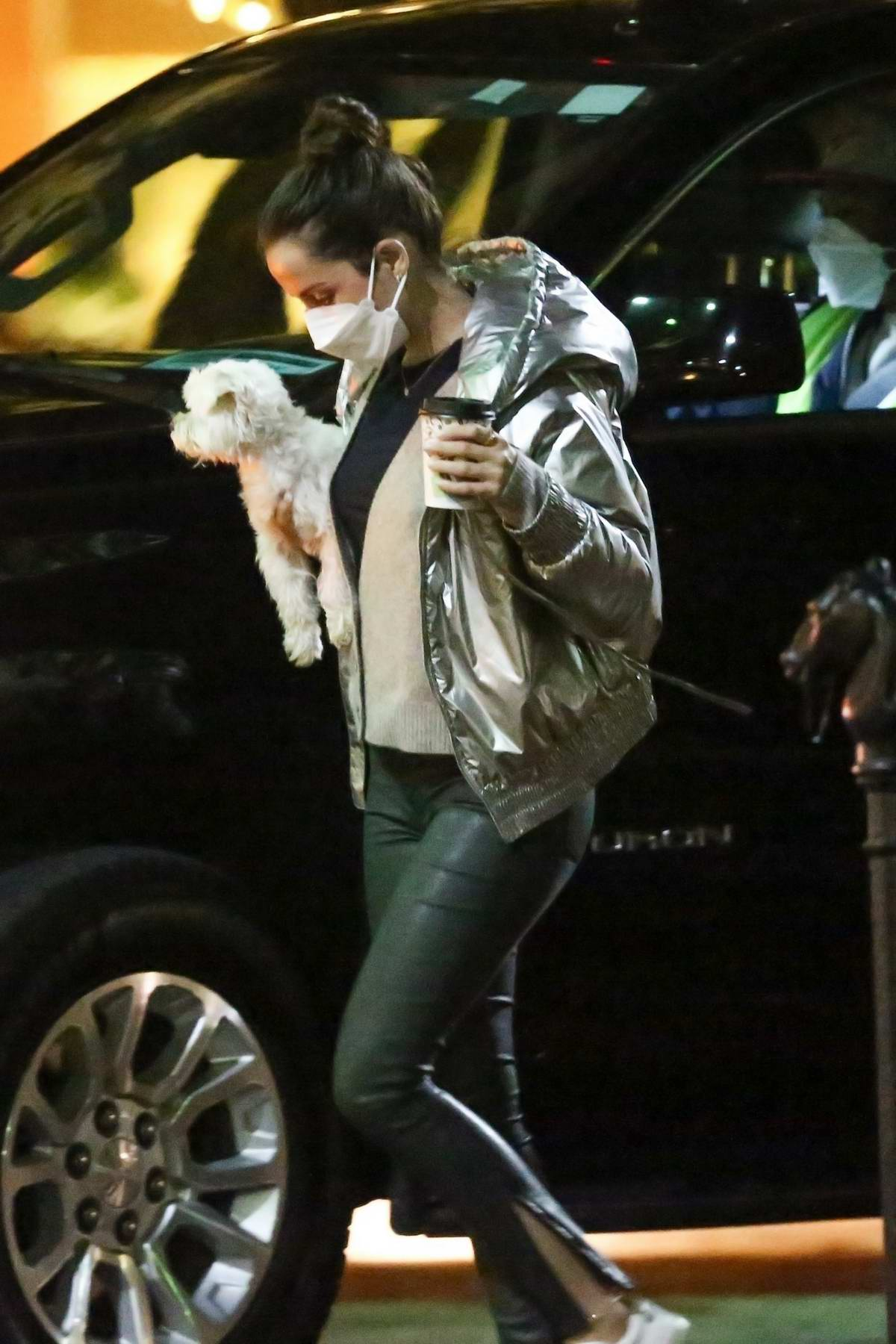 Ana de Armas carries her pup and a coffee after finishing a day of filming in New Orleans, Louisiana