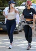 Ana de Armas sports a cream top and navy leggings while out hiking with a friend in Hollywood, California