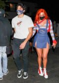 Anastasia Karanikolaou and Noah Centineo hold hands as they leave a Halloween party in Los Angeles