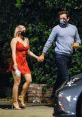 Ariel Winter looks cute in a red dress during a romantic date night with boyfriend Luke Benward in Los Angeles