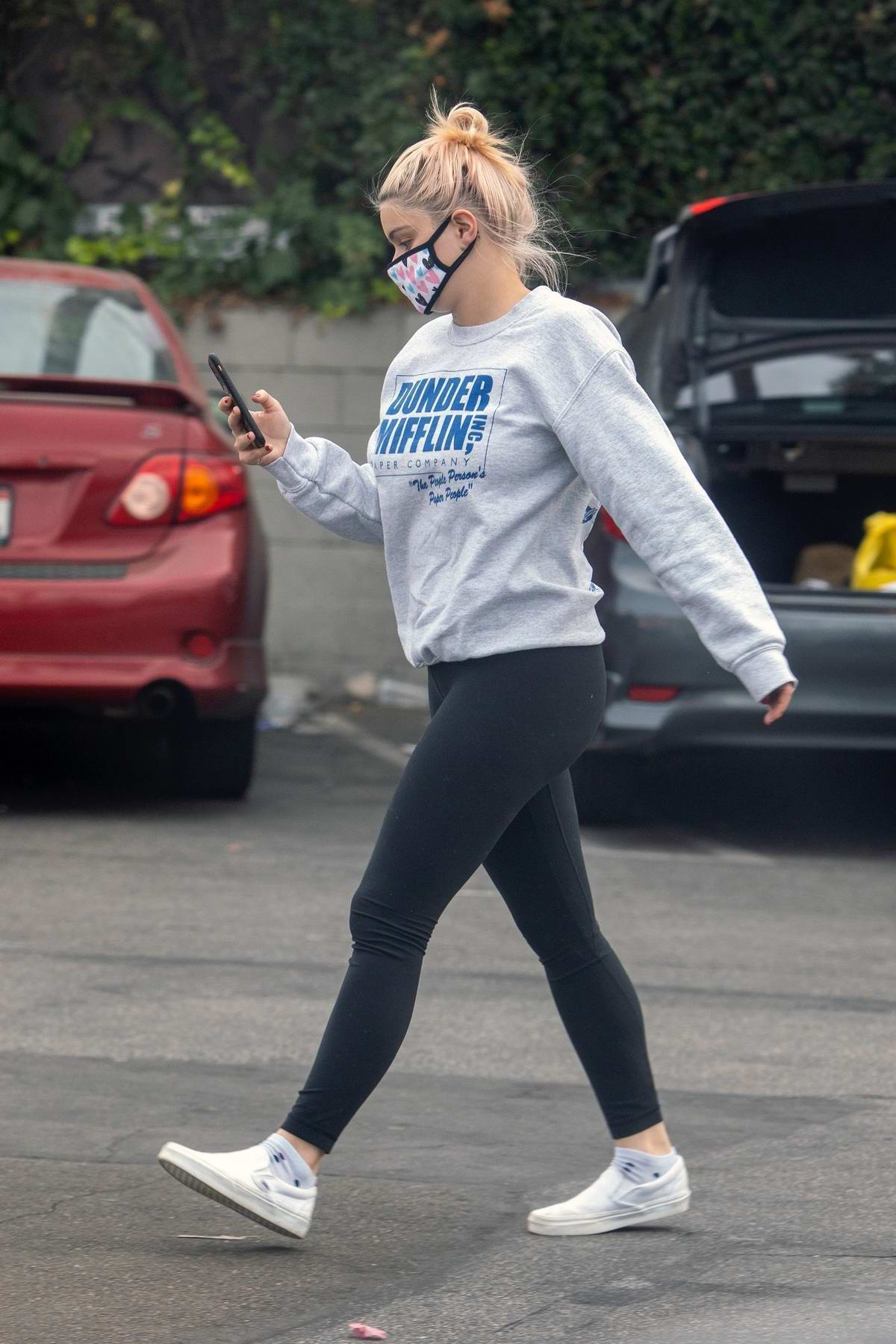 Ariel Winter seen wearing 'The Office' sweatshirt and leggings while out shopping at CVS in Studio City, California