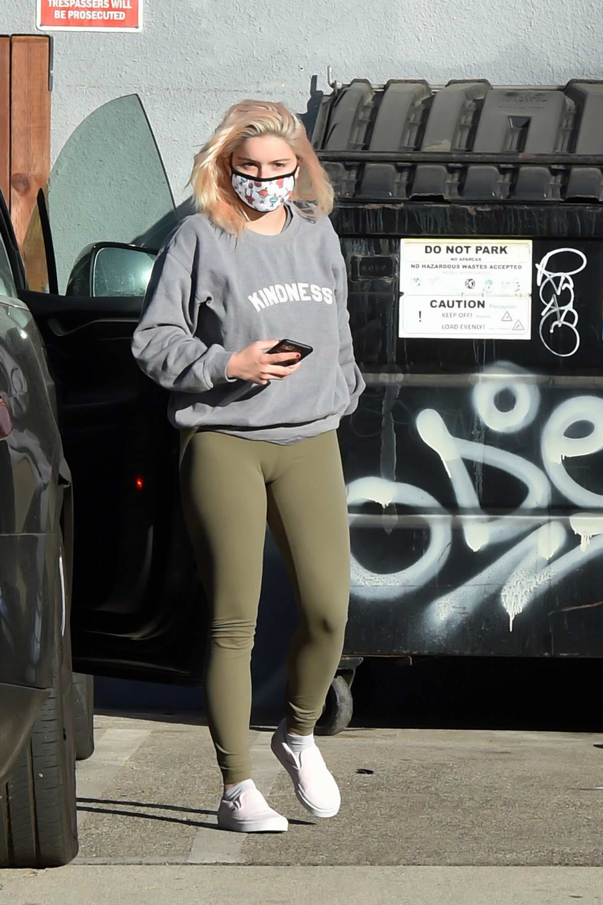 Ariel Winter sports a grey sweatshirt and green leggings while making a stop at a studio in Los Angeles