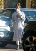 Ashley Tisdale shows her baby bump in a white turtleneck while out running errands in Los Angeles