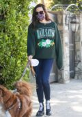 Aubrey Plaza dons green 'Hail Satan' sweatshirt and skinny jeans while walking her dogs in Los Angeles