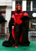 Bebe Rexha looks striking in red during her performance at Macy's Thanksgiving Day Parade in New York City