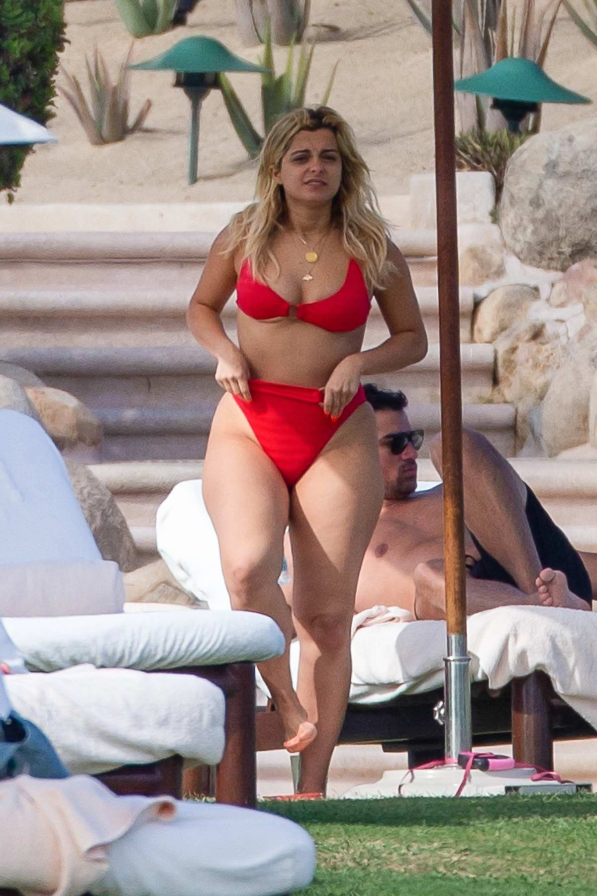 Bebe Rexha looks stunning in a red bikini during a romantic getaway with boyfriend Keyan Safyari in Cabo San Lucas, Mexico