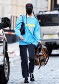 Bella Hadid carries her Louis Vuitton and Chanel bags as she steps out of her apartment in New York City